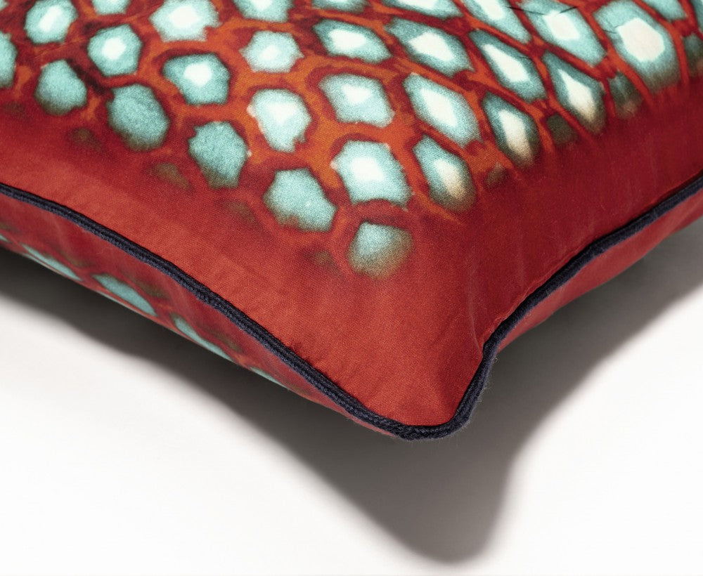 Close up of the Ambre red silk cushion