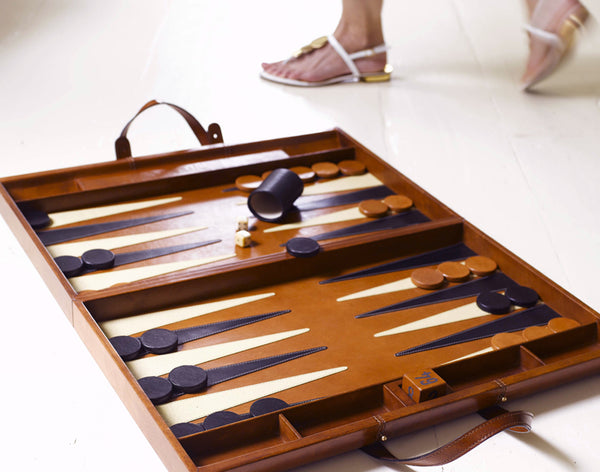 Leather Backgammon Board on floor with feet