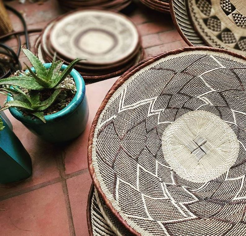 Batonga Handwoven trays on floor with plants