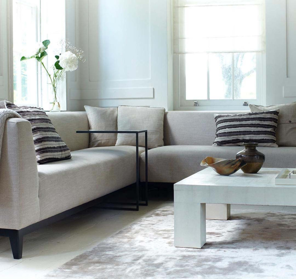 C table over sofa with coffee table and jacaranda rug
