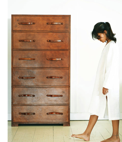 Havana Leather Chest of Drawers with girl walking