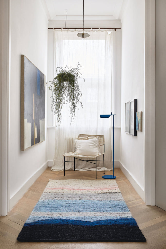 Mohair Rug in Hallway with paintings and chair