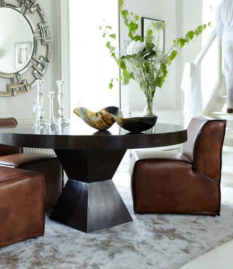 Shikari Dining Table with Leather chairs horn bowls and other decor