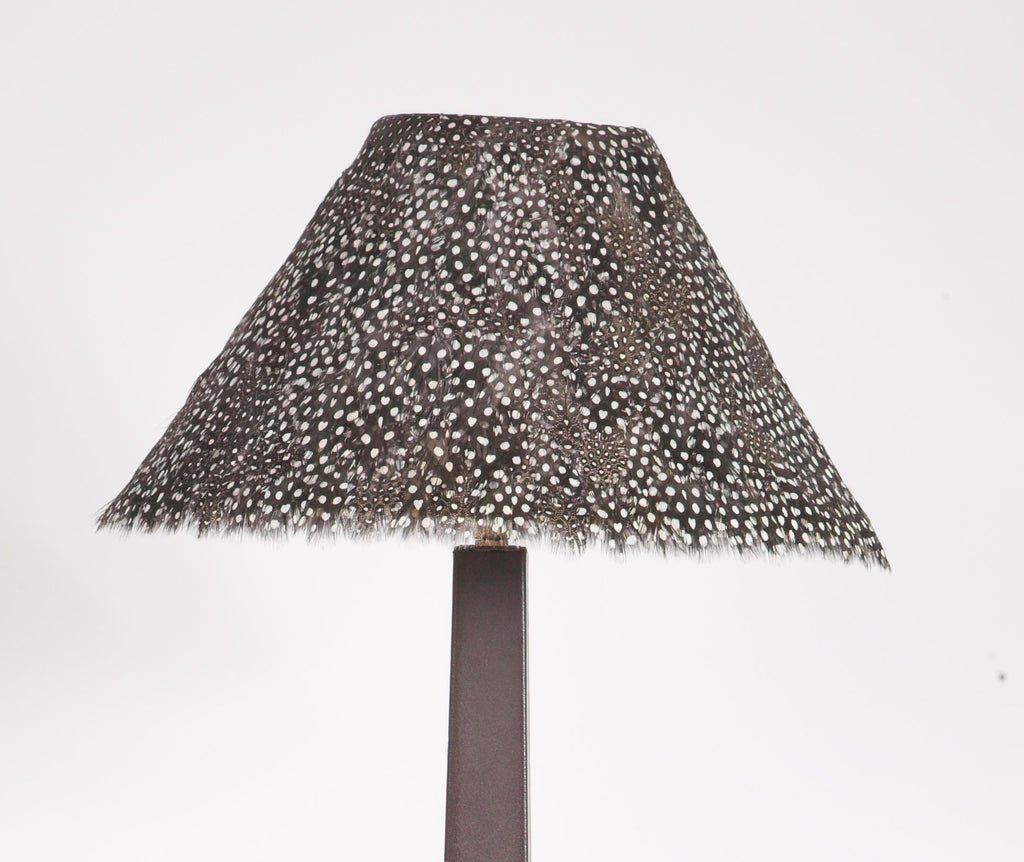 Guinea Foul Lamp Shade on dark brown stand
