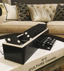 Domino Games set on Chanel book with cushions and sofa in back