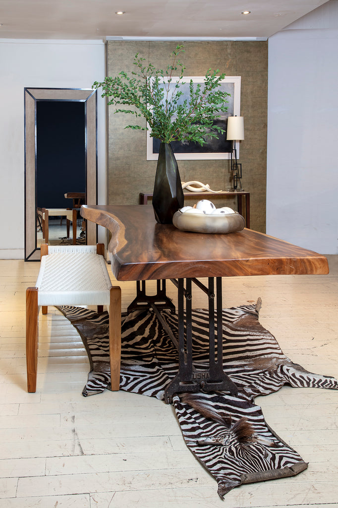 Zebra hide underneath raw wood table