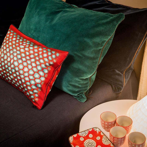 Ambre Cushion with other large cushions, and red cups