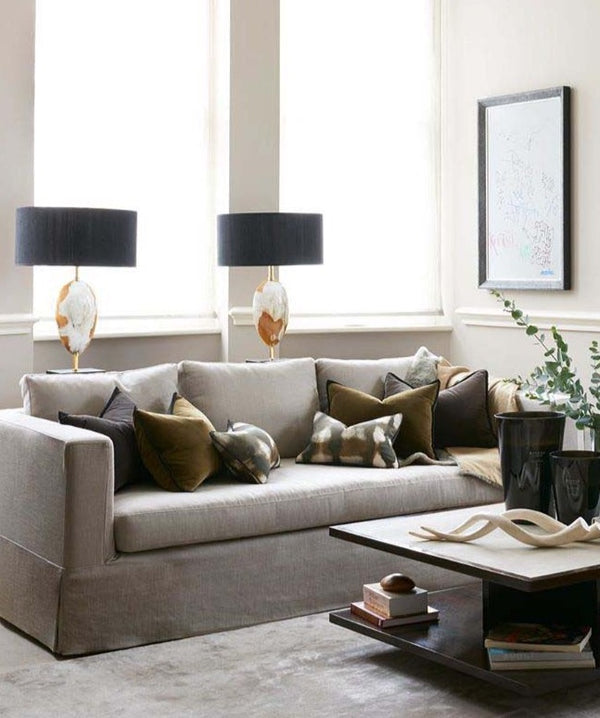 Arca Horn Oval lamps behind sofa