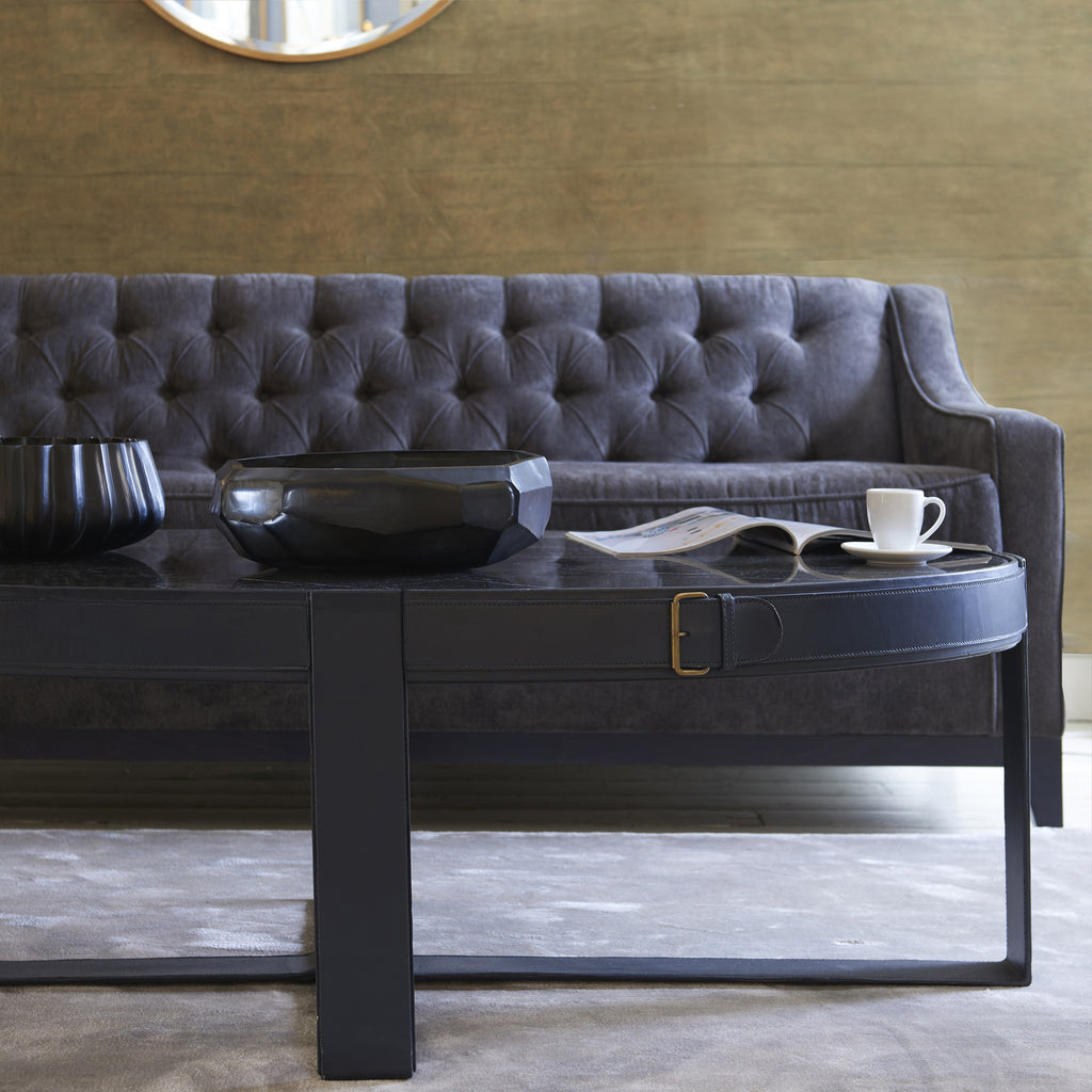 Camera Leather Buckle Oval Coffee Table modelled in a lounge scenario