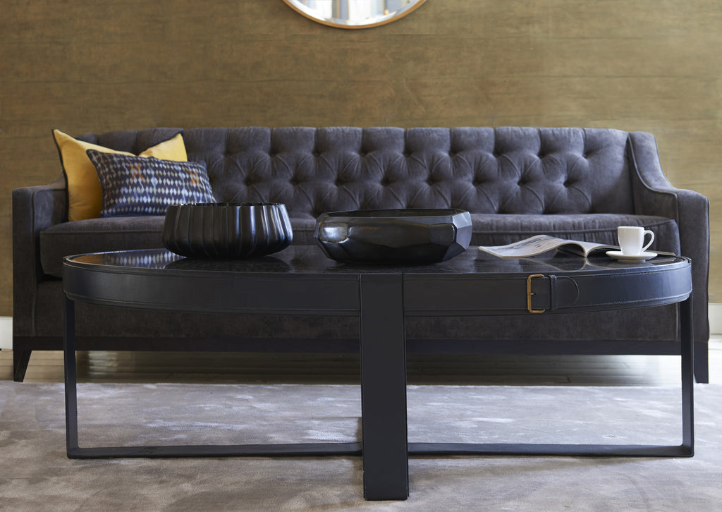 Camera Leather Buckle Oval Coffee table shown in living room