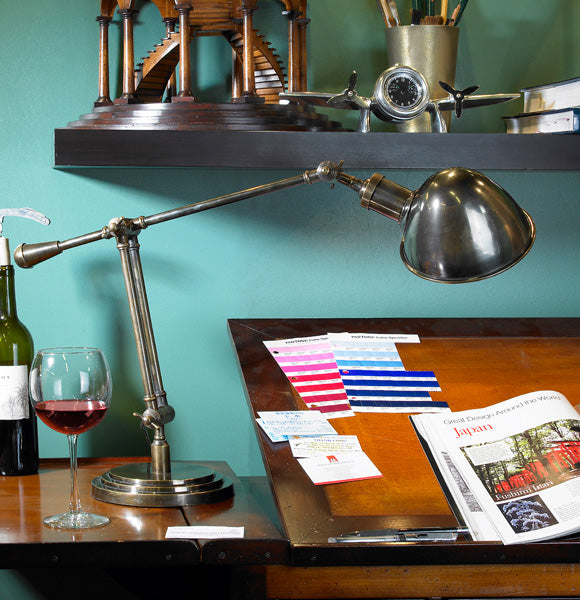 Concorde Desk Lamp on Desk with Wine and Magazine