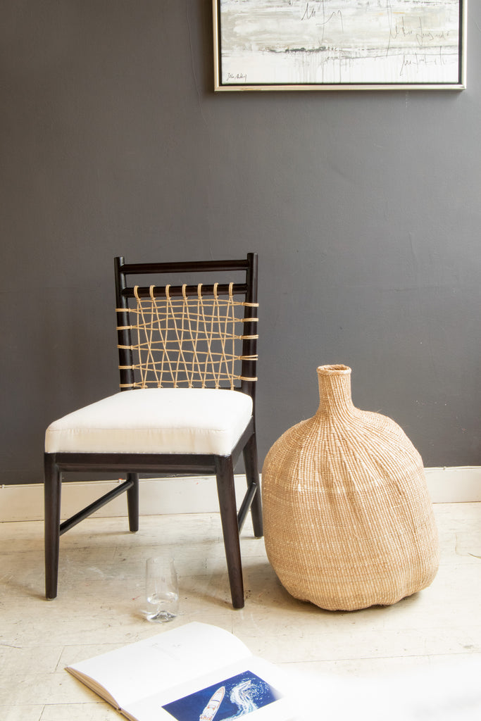 Organic Gourd Basket next to chair