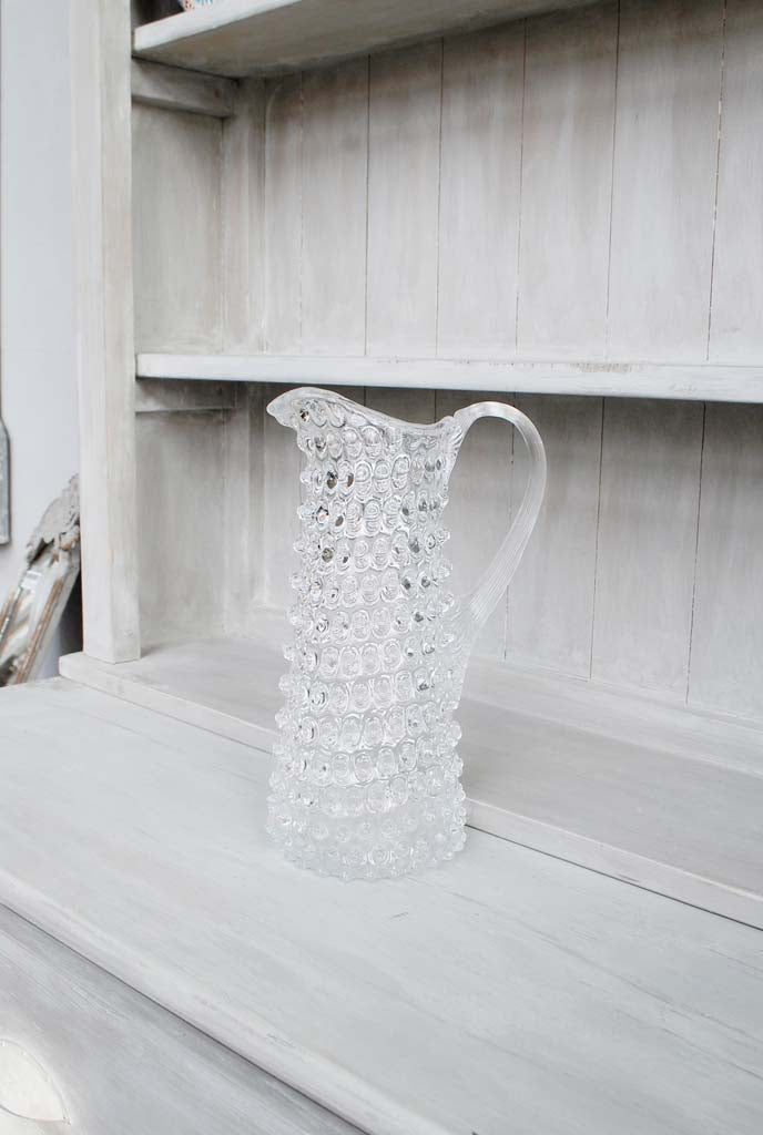 Tall Hobnail Glass Jug with background
