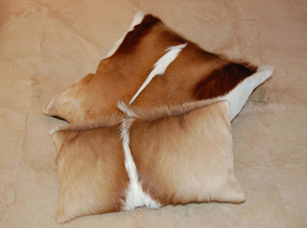 Springbok Hide Cushions on bed