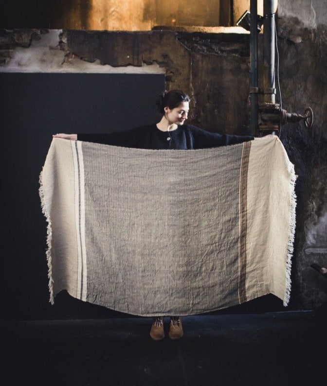 Lady holding Belgian Beeswax Throw