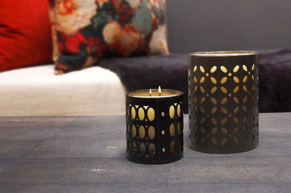 Tall and Small Geometric candles on shagreen table with cushions