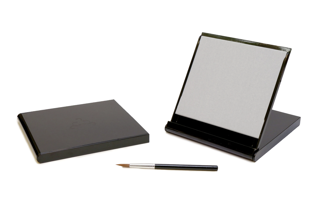 Mini folding grey Buddha board in a black case with paintbrush