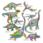 Load image into Gallery viewer, T-shirt design depicting glow in the dark dinosaur skeletons against illustrated dinosaurs including: camarasaurus, pteranodon, tyrannosaurus, gallimimus, archaeopteryx,  stegosaurus, plesiosaurus, brachiosaurus, and styracosaurus.