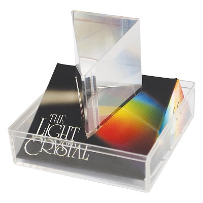 Retail packaging for the Light Crystal Prism. The prism is packaged in a clear acrylic box and is a triangular prism in shape and made of clear acrylic.
