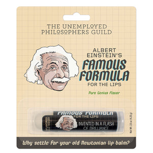 "Retail packaging for Albert Einstein's Famous Formula for the Lips lip balm. Lip balm comes in a stick with a picture of Einstein printed on in. Text reads ""invented in a flash of brilliance!"" and ""why settle for your old Newtonian lip balm?"""