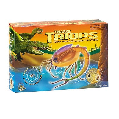 "Retail packaging for Triassic Triops activity kit. The package depicts a hatched triop creature against an illustrated triassic background. Packaging advertises ""hatch your own ancient creatures"", ""they're alive!"", and ""just add water"""