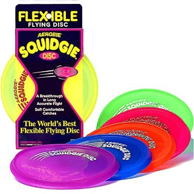 A yellow aerobie disc in retail packaging. Five other discs are displayed in front of the disc to show other available colour options: purple, blue, orange, red, and green.