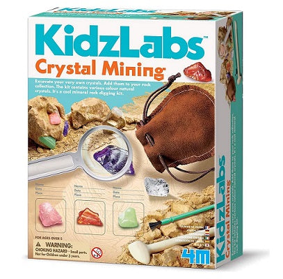 Retail packaging for a crystal mining kids science activity kit. The packaging demonstrates that the activity involves digging into sediment to unearth crystal specimens.