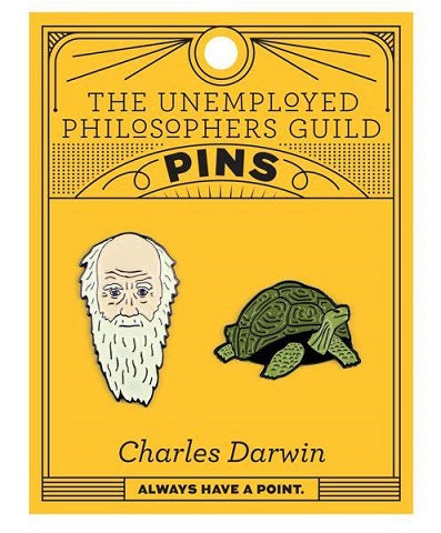 Orange card with 2 enamel pins - one of Charles Darwin and one of the Galapagos tortoise