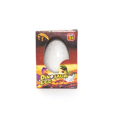 Retail packaging for the Giant Growing Dino Egg toy.  A white speckled egg sits in a cardboard box that depicts baby dinosaurs hatching.