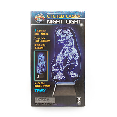 "Retail packaging for the Etched Laser Night Light. The night light is a standalone piece of glass etched into a t-rex design, sitting in a black base. When turned on, the etchings in the glass illustrate the t-rex design. The packaging advertises ""multiple colour light modes,"" ""plugs into your computer,"" ""USB adapter included"" and ""sleek and durable design"""