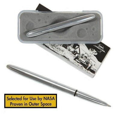 Chrome finish bullet style Fisher Space pen displayed in plastic packaging. A yellow text box reads 'selected for use by NASA; proven in outer space')