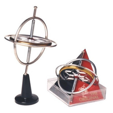 Assembled metal gyroscope next to retail packaging