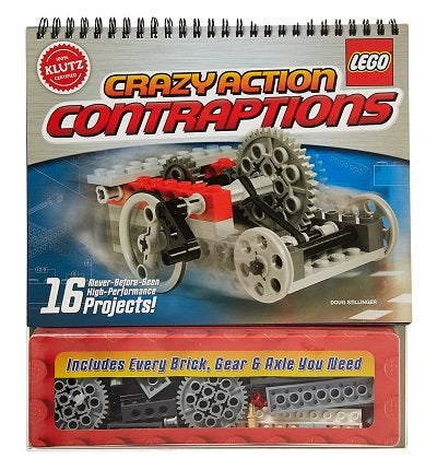 A soft cover book with wire binding across the top.  The cover of the book is illustrated with one of the LEGO projects inside of the kit. The cover advertises that there are 16 never-before-seen high-performance projects included in the kit.