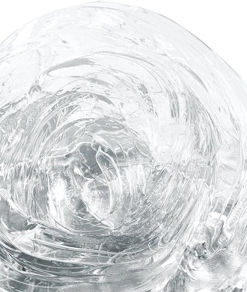 Closeup of a sample of Liquid Glass putty that demonstrates its transparency