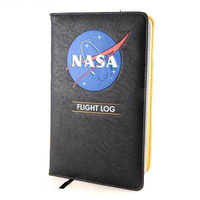 "A black imitation leather softcover notebook that is decorated in the NASA logo and reads ""Flight Log"" in white capitalized letters"