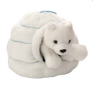 A stuffed plush toy of a polar bear inside of an igloo.