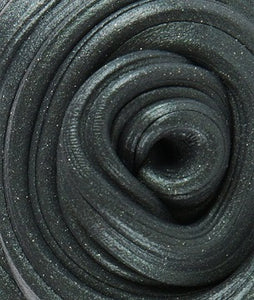 Closeup of magnetic putty texture: black with sparkles