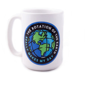 "A white ceramic mug with a printed cartoon graphic of the Earth spinning. Curved text around the mug reads ""The rotation of the Earth really makes my day"""
