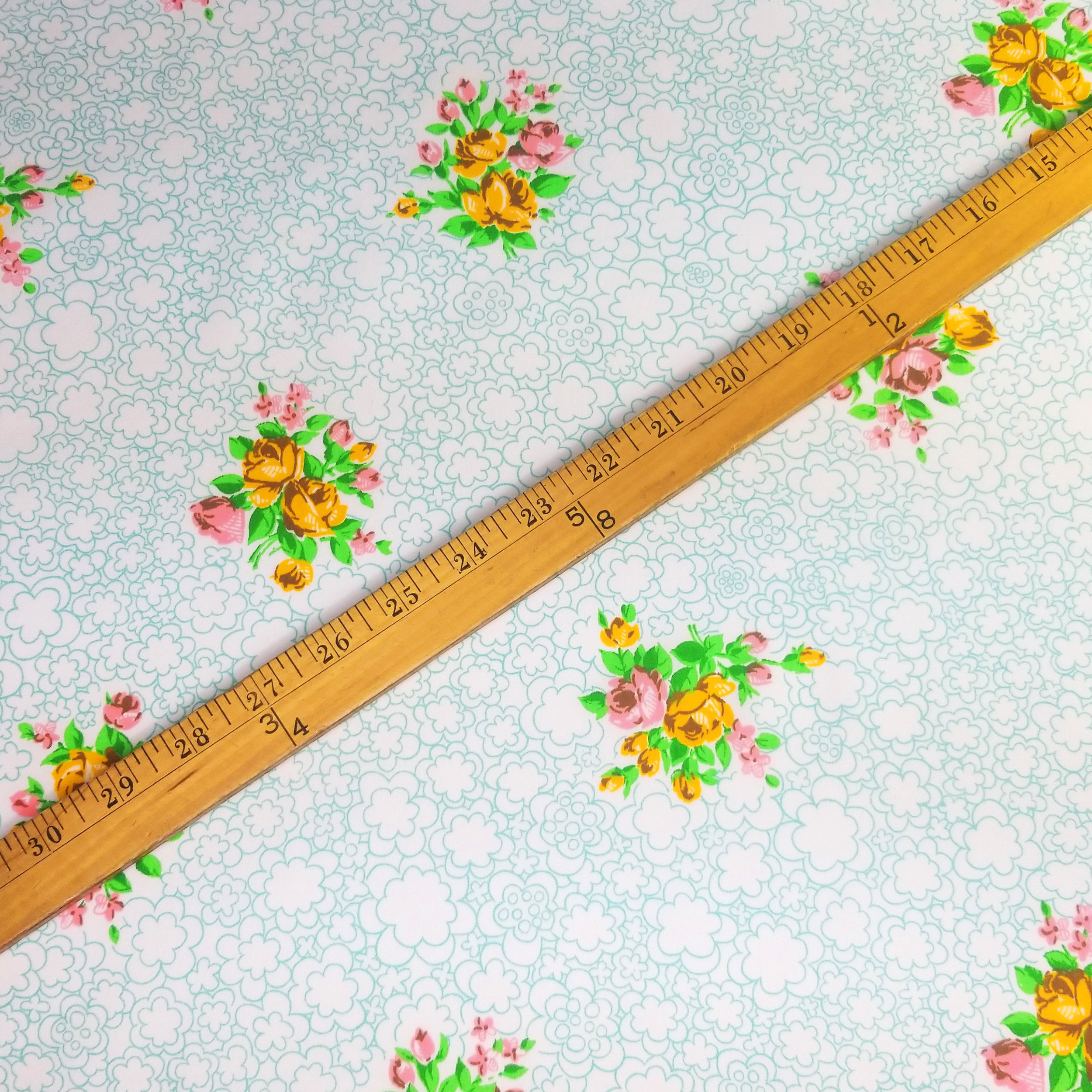 VINTAGE FABRIC BABY BOLT HALF-YARD -  SEVENTIES' FLORAL BOUQUET ON WHITE WITH FLUFFY SEAFOAM FLOWER CLOUDS