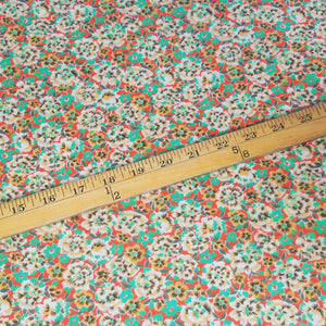 VINTAGE FABRIC BABY BOLT HALF-YARD -  FIFTIES' FLORAL PRINT IN GREENS, PEACH & BROWN ON ORANGE