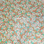 Load image into Gallery viewer, VINTAGE FABRIC BABY BOLT HALF-YARD -  FIFTIES' FLORAL PRINT IN GREENS, PEACH & BROWN ON ORANGE