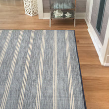 las palmas area rug in living room in colour ocean