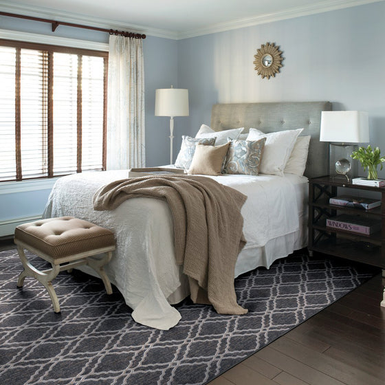 Clifton area rug in bedroom in colour steel
