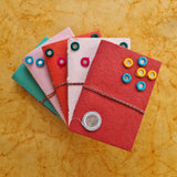 handmade paper diary with mirror and thread binding in red colour