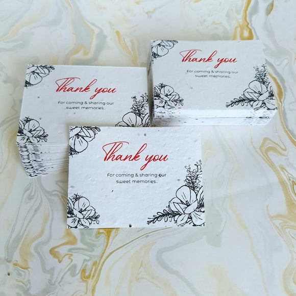 Plantable seed paper thank you cards with greeting notes printed in red and black colour ink