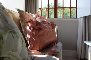 photo of the diaper bag in dusty pink
