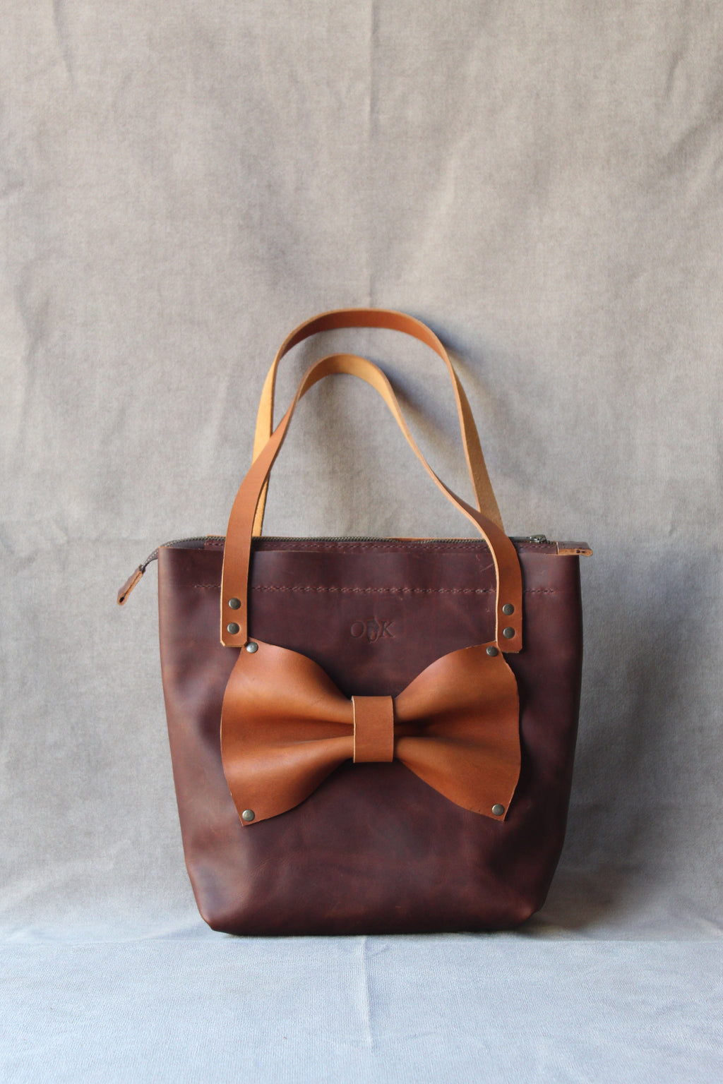 jani bow tote in dark brown with tan bow and tan straps