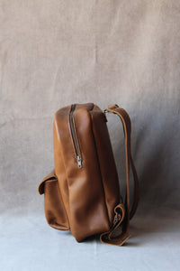 round backpack in tan