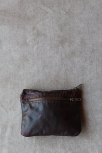 photo of the utility pouch in maroon