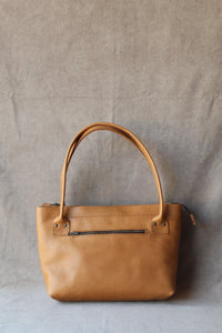 the cybil handbag in tan